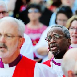 Presiding Bishop elect Michael Curry, of North Carolina, sings during a rally against gun violence Sunday, June 28, 2015, from the Salt Palace Convention Center to Pioneer Park and back in Salt Lake City.