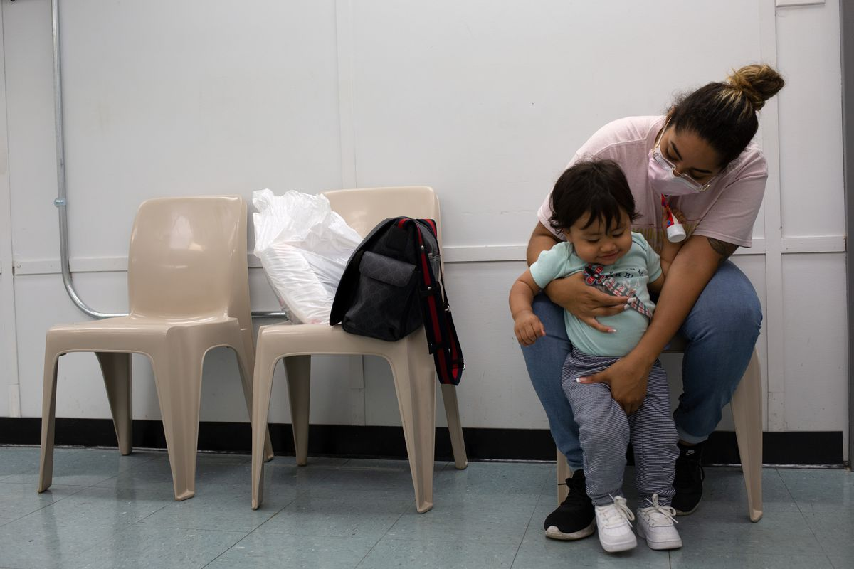 Sophia Garcia plays with her son, Taylin, before they see his father on Rikers Island, July 1, 2021.