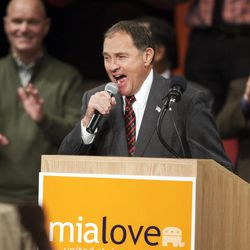 Utah Gov. Garry R. Herbert yells out to the crowd during a campaign rally Wednesday, Oct. 8, 2014, for Mia Love at Thanksgiving Point in Lehi.