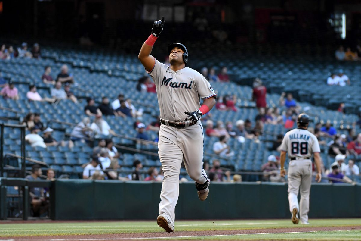 Jesús Aguilar of the Miami Marlins gestures after hitting a two-run home run against the Arizona Diamondbacks during the first inning at Chase Field
