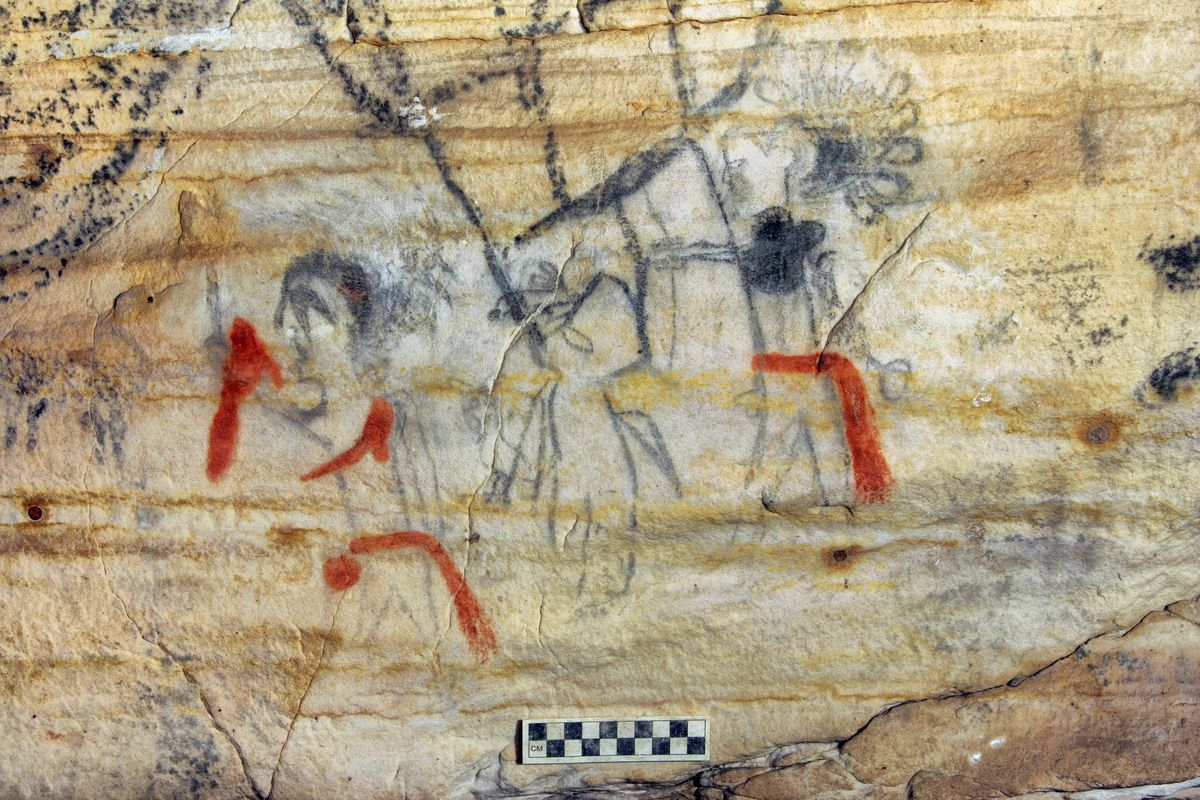"""This photo shows a Missouri cave featuring artwork from the Osage Nation that's more than 1,000 years old. The cave was sold at auction. The art inside """"Picture Cave"""" shows humans, animals and mythical creatures. Experts who have studied the cave were concerned about the auction, but the director of the auction company says protections are in place to prohibit the new buyer from exploiting the cave, including a Missouri law that makes doing so a crime."""