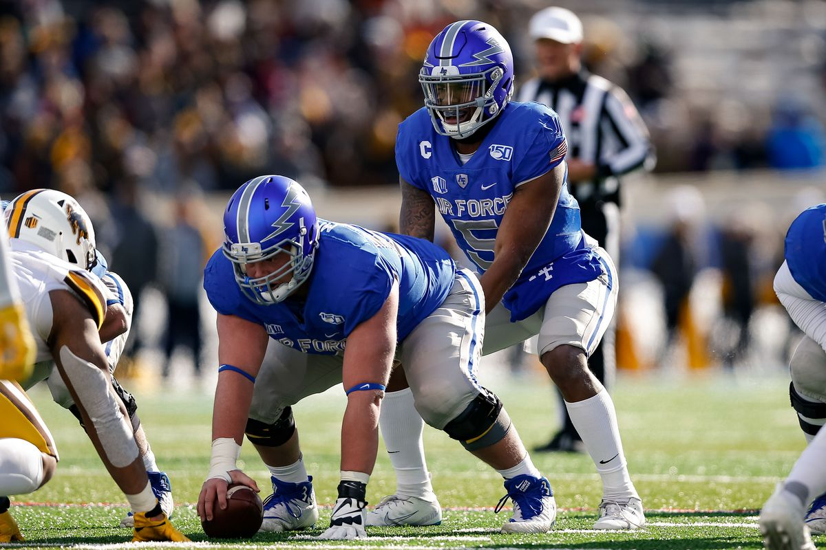 Air Force quarterback Donald Hammond III behind offensive lineman Kyle Krepsz in the first quarter against Wyoming.