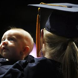 Dani Freebairn holds her daughter Brylie as she tries to listen to Spring Commencement Exercises at BYU Thursday, April 19, 2012 in the Marriott Center.