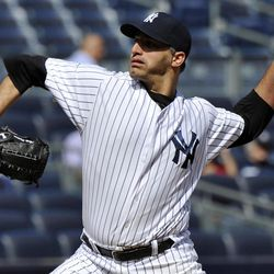 New York Yankees starter Andy Pettitte delivers a pitch to the Toronto Blue Jays during the first inning of the first baseball game of a doubleheader, Wednesday, Sept. 19, 2012, at Yankee Stadium in New York.