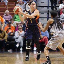 Connecticut Sun's Rachel Banham (1) is guarded by San Antonio Stars' Moriah Jefferson (4).