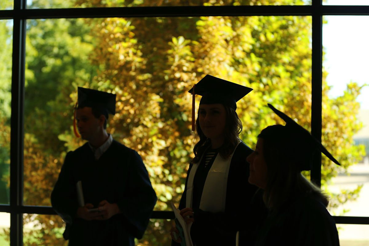 Graduates walk around the concourse during Brigham Young University summer commencement in Provo on Thursday, Aug. 16, 2018.