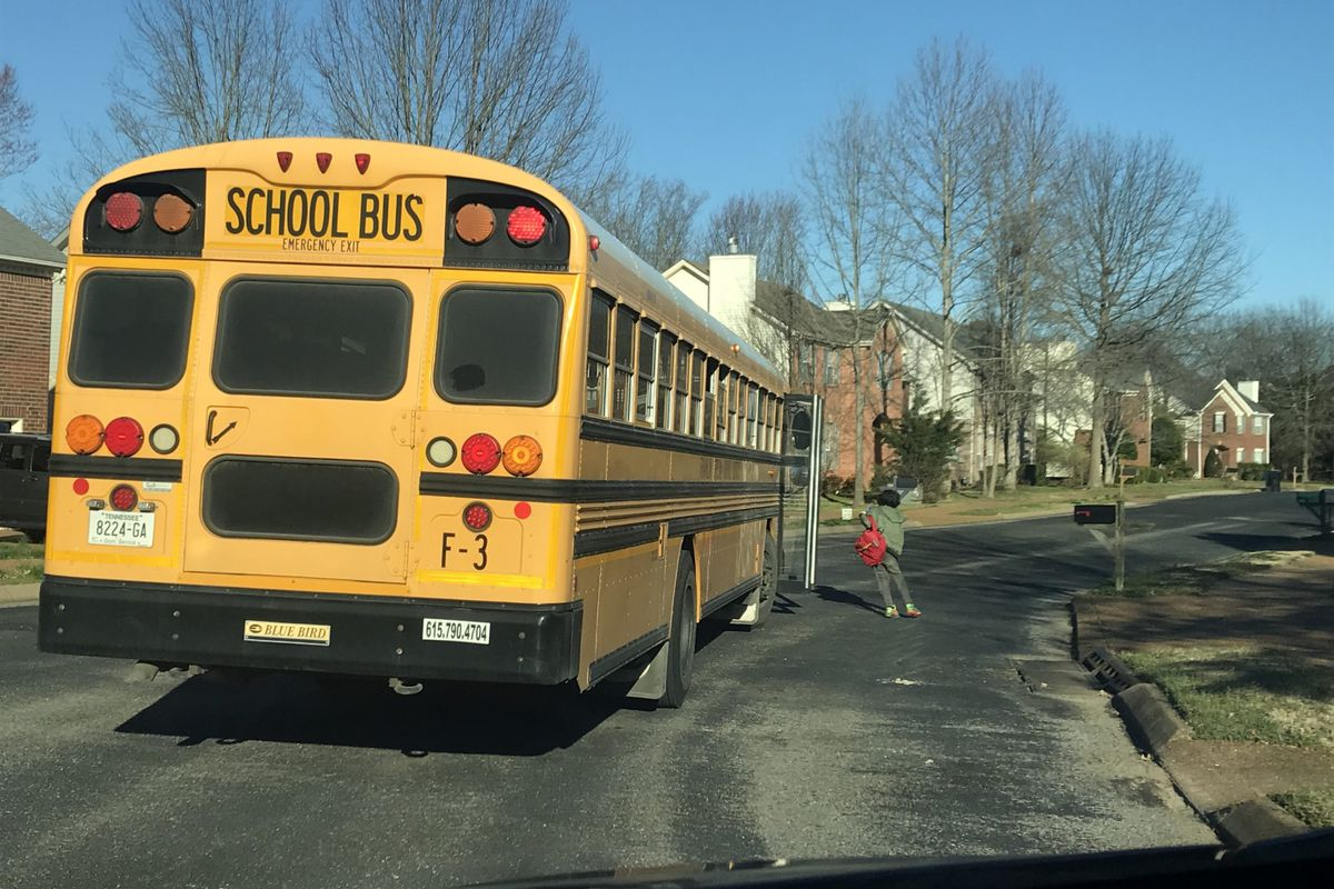 A student steps off the bus Thursday in Williamson County, where two school districts will be closed for two days after a resident was diagnosed with the new coronavirus. Williamson County is located south of Nashville.