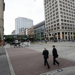 When initially designed, Salt Lake City was laid out with streets wide enough for a wagon to turn around. The width made it easy for the city to adapt streets for automobile and mass transit use in later years. Photo of Main Street in Salt Lake City taken on Wednesday, May 29, 2013.