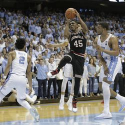 North Carolina's Joel Berry II (2) and Kennedy Meeks, right defend against Louisville's Donovan Mitchell (45) during the second half of an NCAA college basketball game in Chapel Hill, North Carolina, Wednesday, Feb. 22, 2017. North Carolina won 74-63.