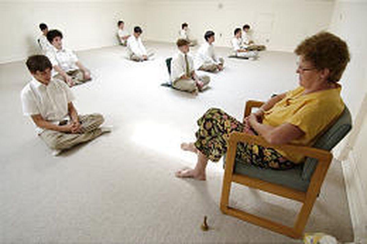 Transcendental Meditation students practice in front of teacher Siggi Lamothe in Fairfield, Iowa.