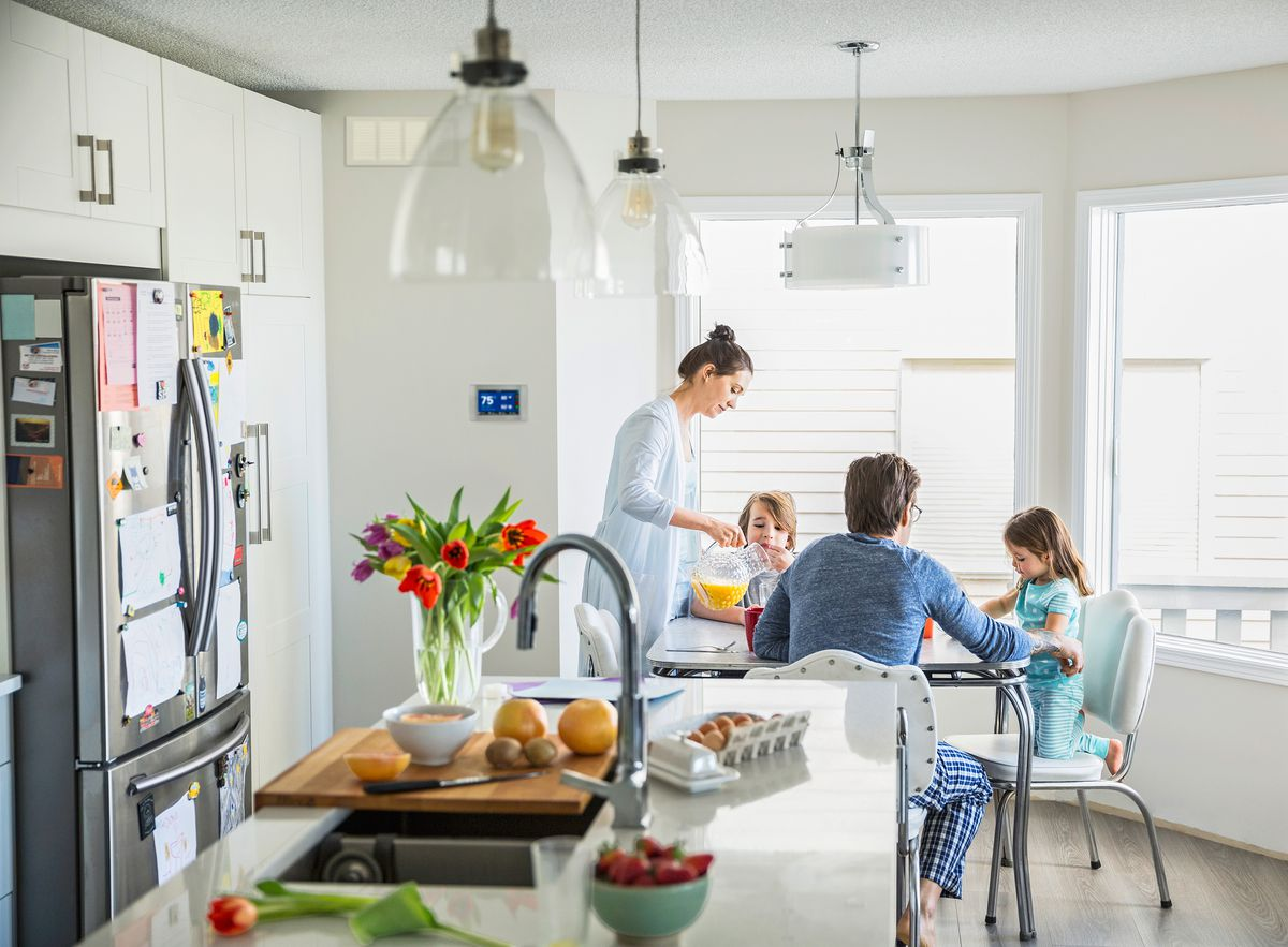 Family Eats In Kitchen That Has Zoned System Air