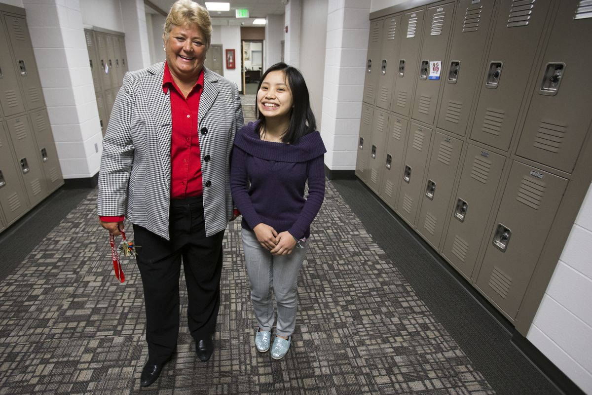 Barbara Brouwer, principal at Southport High School, poses for a photo with Elly Mawi, a senior at the school. Brouwer has been instrumental in leading the school as its English language learner population has grown.