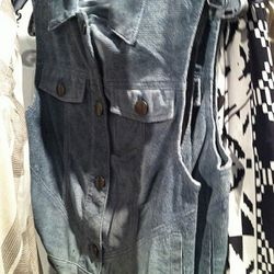 """Look for this vest in the """"additional markdowns"""" rack first. Then check the overstock."""