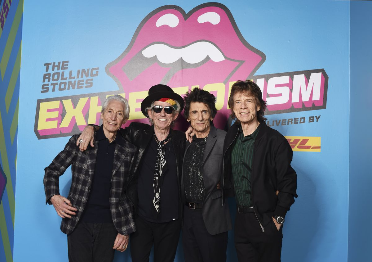 """Charlie Watts (from left), Keith Richards, Ronnie Wood and Mick Jagger of the Rolling Stones attend a preview of 'The Rolling Stones: Exhibitionism"""" at Saatchi Gallery on April 4, 2016, in London, England.   Dave J. Hogan Photo"""