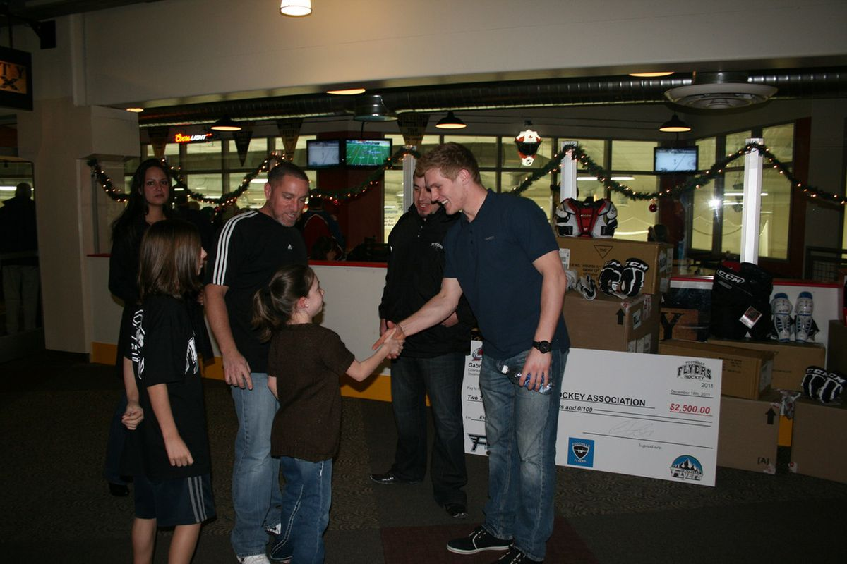 Gabriel Landeskog donates $2,500 dollars and $2,500 of equipment to a local hockey charity on December 18th, 2011. (S. Gauthier, C. Bradley)