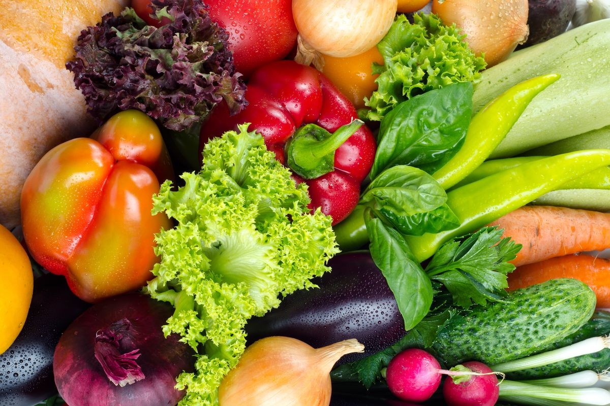 A pile of fresh vegetables and leafy greens.