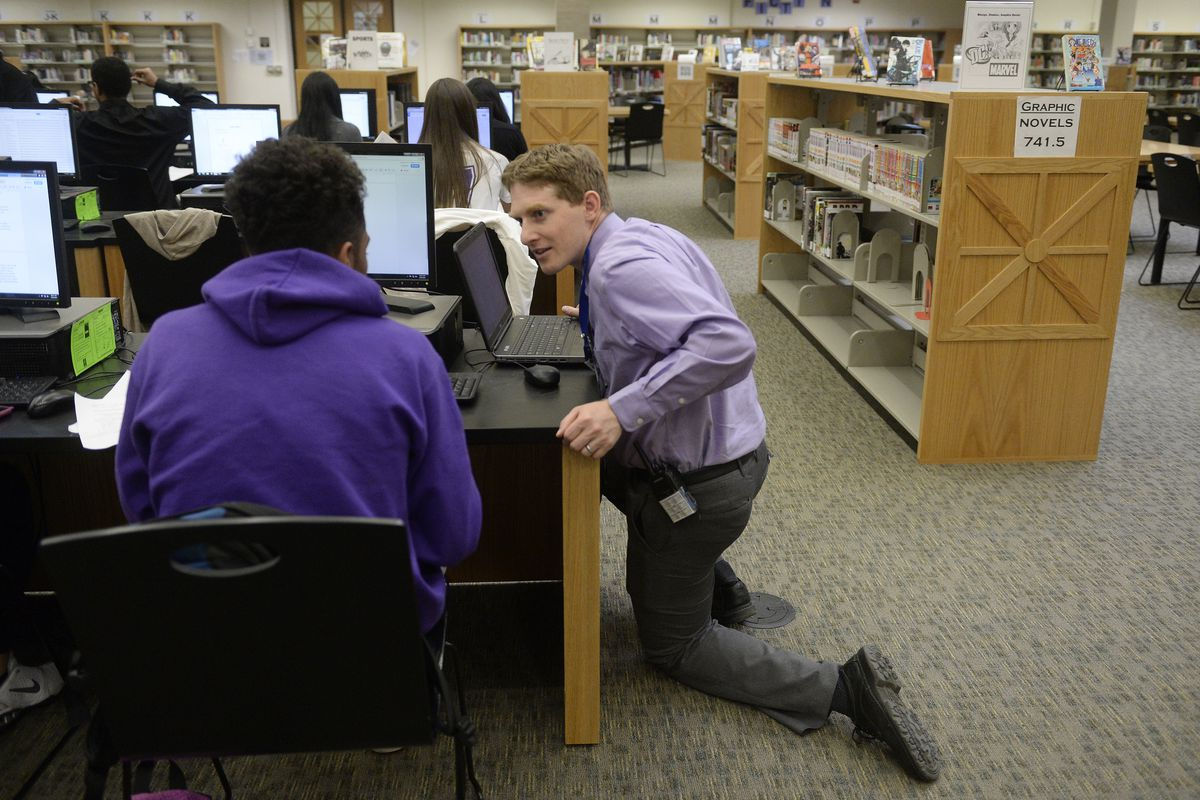 Principal Scott Wolf talks with a student in 2015.