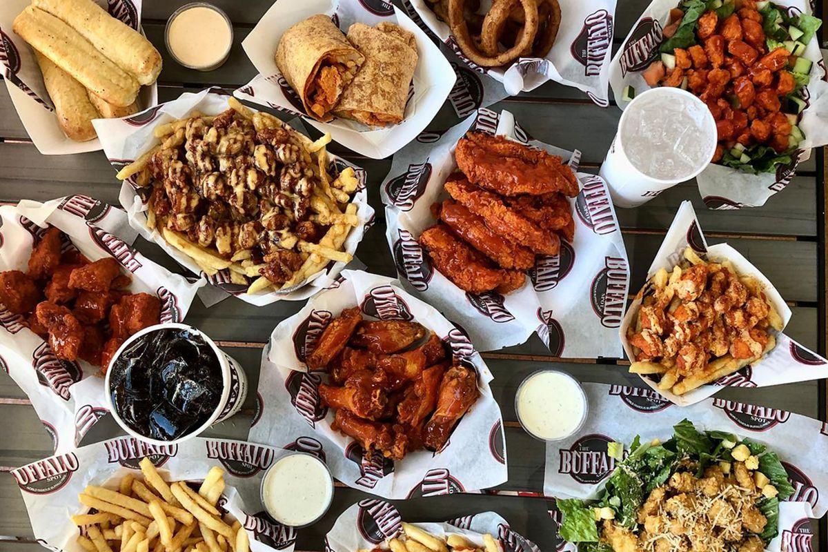 Servings of Buffalo fries, wings, tenders, and bread sticks on The Buffalo Spot menu.