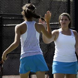 Katie Panushka (left) and Kelsey Almony of St. Joseph compete against Arie and Amanda Naylor of Manti (not pictured) in the State 2A Tennis first seed doubles tournament at Liberty Park in Salt Lake City Saturday, Sept. 29, 2012.