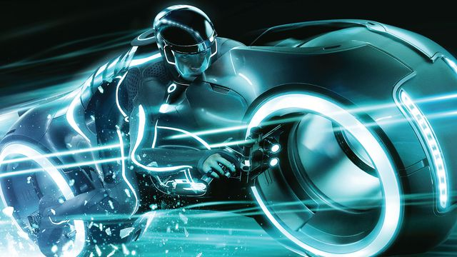 Sam Flynn rides a lightcycle in a still from Tron: Legacy