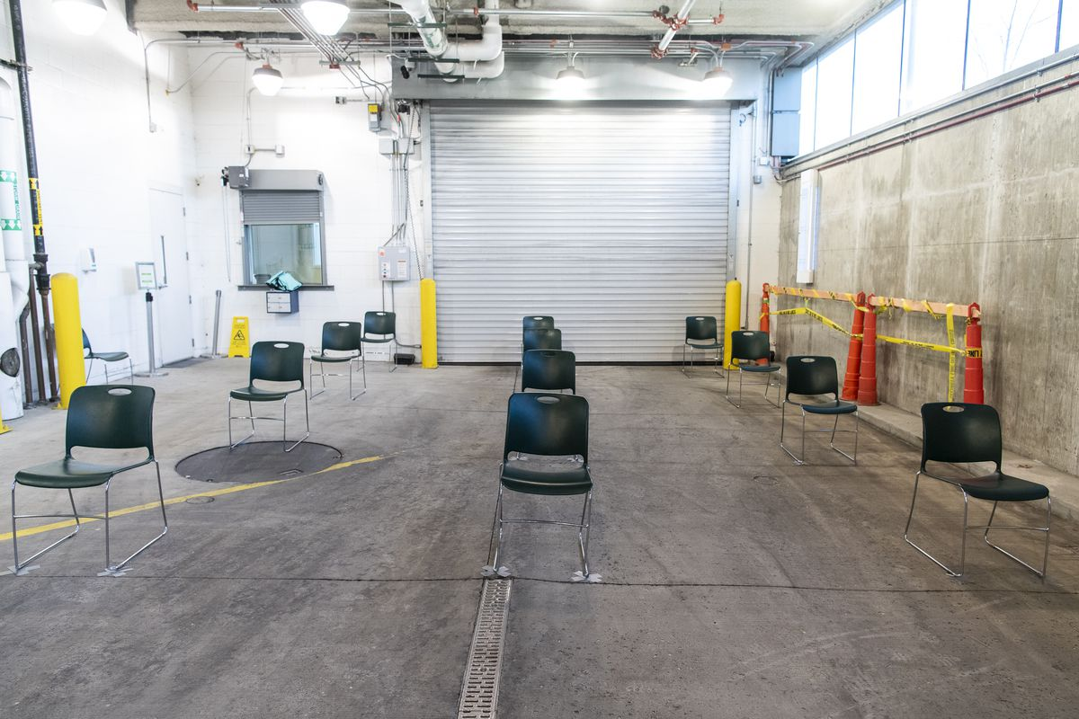 Chairs for patients to sit and wait to be tested, each chair is exactly 6 feet apart, at Rush University Medical Center's forward triage center for Coronavirus placed in one of the hospitals ambulance bays, Tuesday, March 10, 2020.