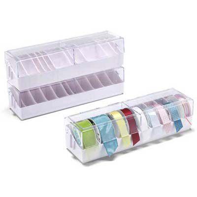 3 transparent ribbon dispenser boxes that hold 9 ribbon rolls each.