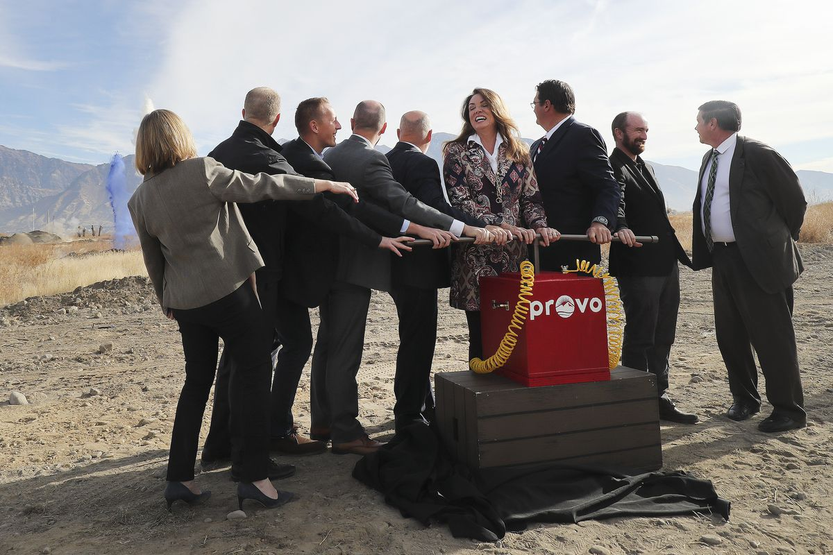 Dignitaries including Utah Lt. Gov Spencer Cox, fourth from left, and Provo MayorMichelle Kaufusi, sixth from left,break ground for a new terminal at the Provo Municipal Airport on Wednesday, Nov. 6, 2019.