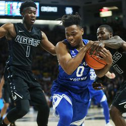 Brigham Young Cougars guard Jahshire Hardnett (0) is defended by Utah State Aggies guard Koby McEwen (1) in Logan on Saturday, Dec. 2, 2017. BYU won 75-66.