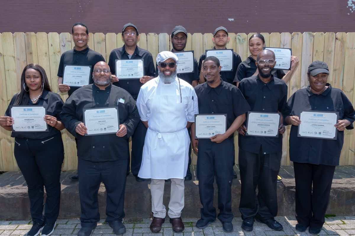 A group of chefs posing together.