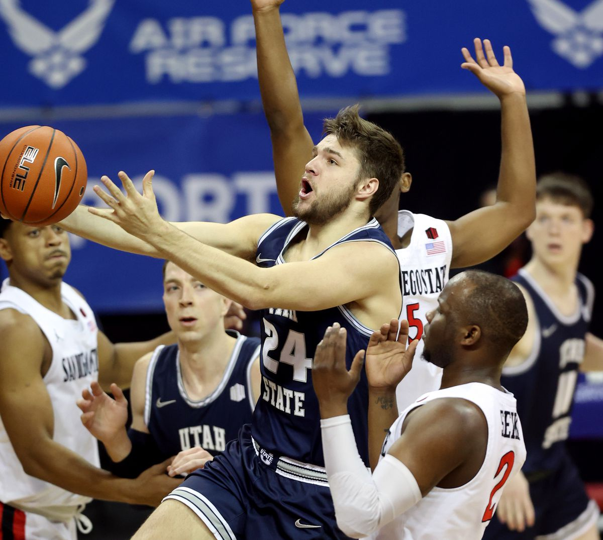 Utah State Aggies guard Rollie Worster (24) drives to the hoop as Utah State and San Diego State play in the championship game of the Mountain West Tournament at the Thomas & Mack Center in Las Vegas on Saturday, March 13, 2021.