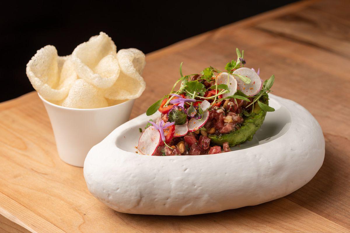 Tuna tartare on Fia Steak coated in a white bowl.