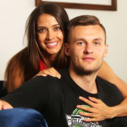 Kyle Collinsworth and his wife, Shea Collinsworth, pose for a photo in their home in Provo on Wednesday, April 22, 2020.