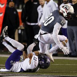 Southern Utah Thunderbirds wide receiver Alex Croyle runs the ball with Weber State Wildcats cornerback Xequille Harry  defending during NCAA football in Cedar City on Saturday, Dec. 2, 2017.