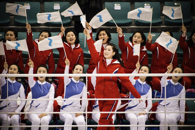 "North Korean cheerleaders prior to the women""s preliminary round ice hockey match between the Unified Korea team and Switzerland."