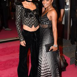 Adriana Lima, in Marc Jacobs, with Gabrielle Union, in Lela Rose.