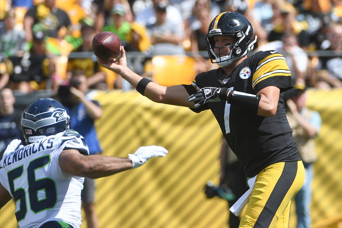 Ben Roethlisberger of the Pittsburgh Steelers attempts a pass as Mychal Kendricks of the Seattle Seahawks defends in the first quarter during the game at Heinz Field on September 15, 2019 in Pittsburgh, Pennsylvania.