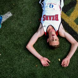 Bear River's Gabriel Wilson rests after the 4A Boys State Cross-Country Championships at Highland High School in Salt Lake City on Wednesday, Oct. 23, 2019.