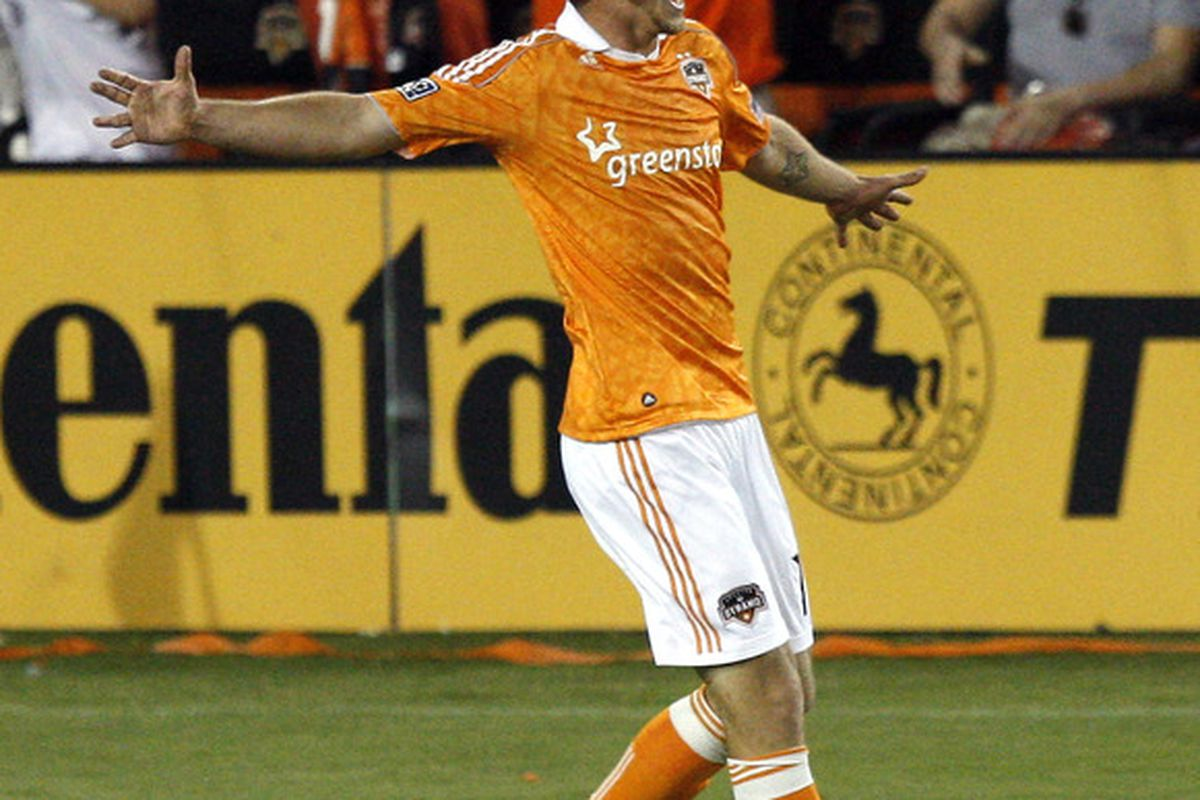 HOUSTON - APRIL 29:  Forward Cam Weaver #15 of the Houston Dynamo celebrates after scoring in the second half against D.C. United at Robertson Stadium on April 29, 2011 in Houston, Texas. Houston won 4-1. (Photo by Bob Levey/Getty Images)