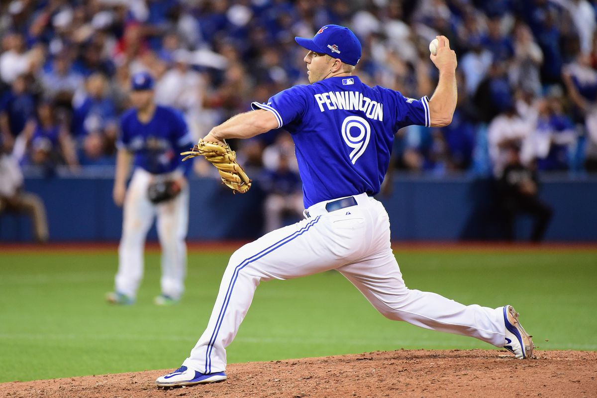 Cliff Pennington #9 of the Toronto Blue Jays throws a pitch in the ninth inning against the Kansas City Royals during game four of the American League Championship Series