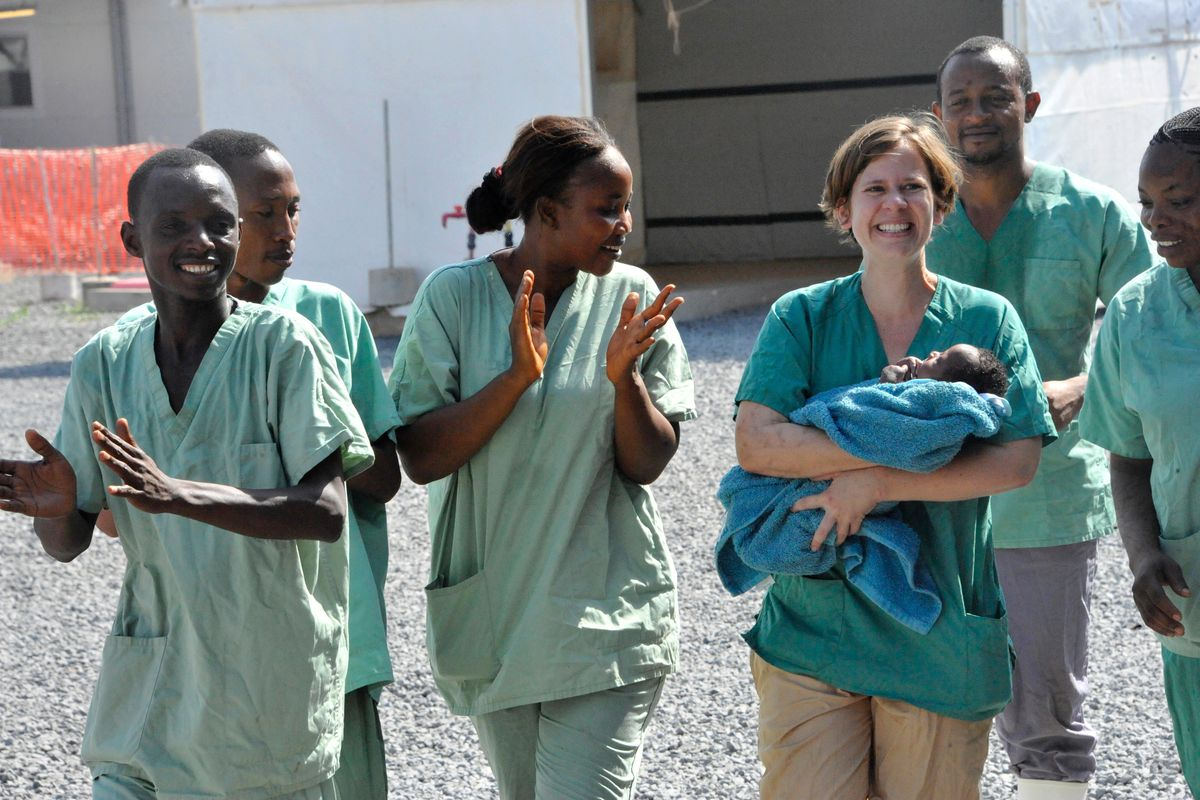Medical workers in Guinea with Noubia, a baby who was the last known Ebola patient in the country.