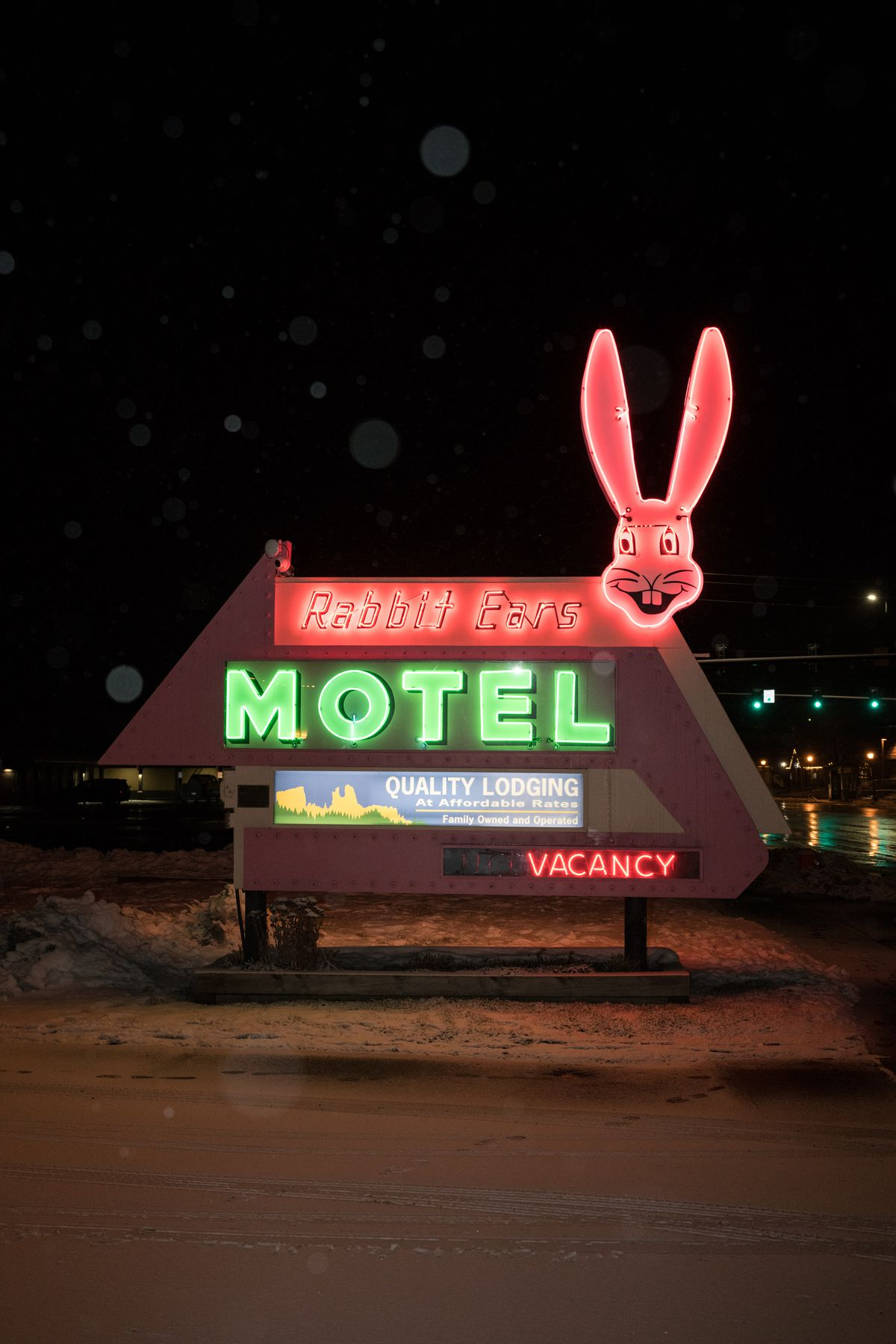 Neon sign at the Rabbit Ears Motel as the name of the hotel with a face of a bunny.
