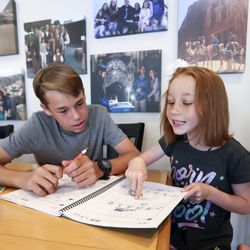 Joseph Hilton helps his sister, Rebekah, with her Chinese in their home in Orem on Thursday, June 25, 2020. Joseph Hilton and four of his siblings attend dual language immersion schools.