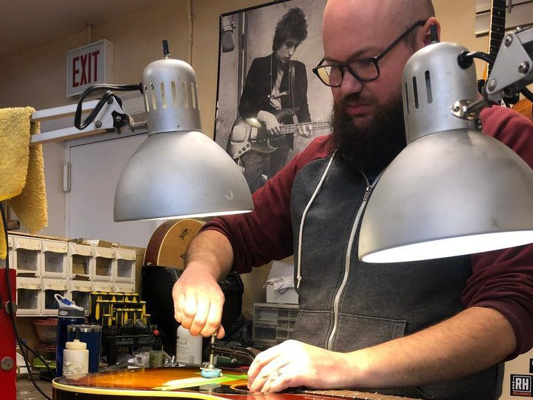 Chicago Fret Works technician Gregory Martin works on a guitar | Ji Suk Yi for the Sun-Times