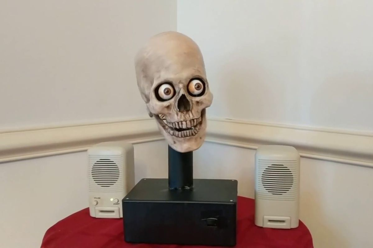A Halloween skull between two speakers
