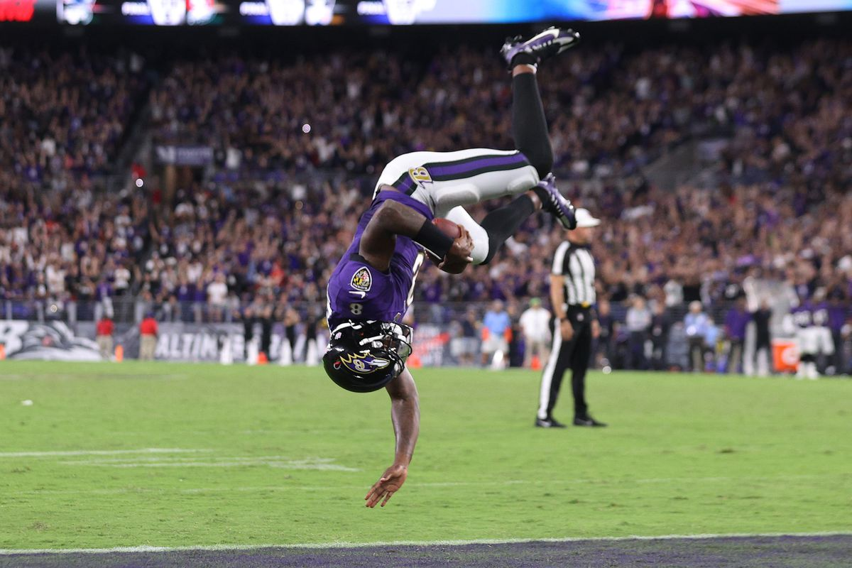 Lamar Jackson #8 of the Baltimore Ravens flips into the endzone for a touchdown against the Kansas City Chiefs during the fourth quarter at M&T Bank Stadium on September 19, 2021 in Baltimore, Maryland.