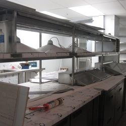 The kitchen, including lighting fixtures from the original location.