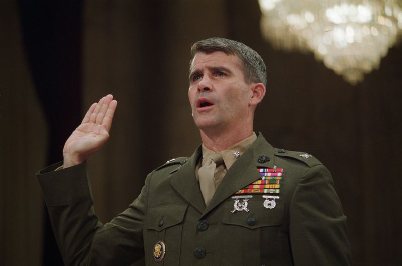 Oliver North, dressed in full military uniform, is sworn in as witness during the 1987 Iran-Contra hearings.