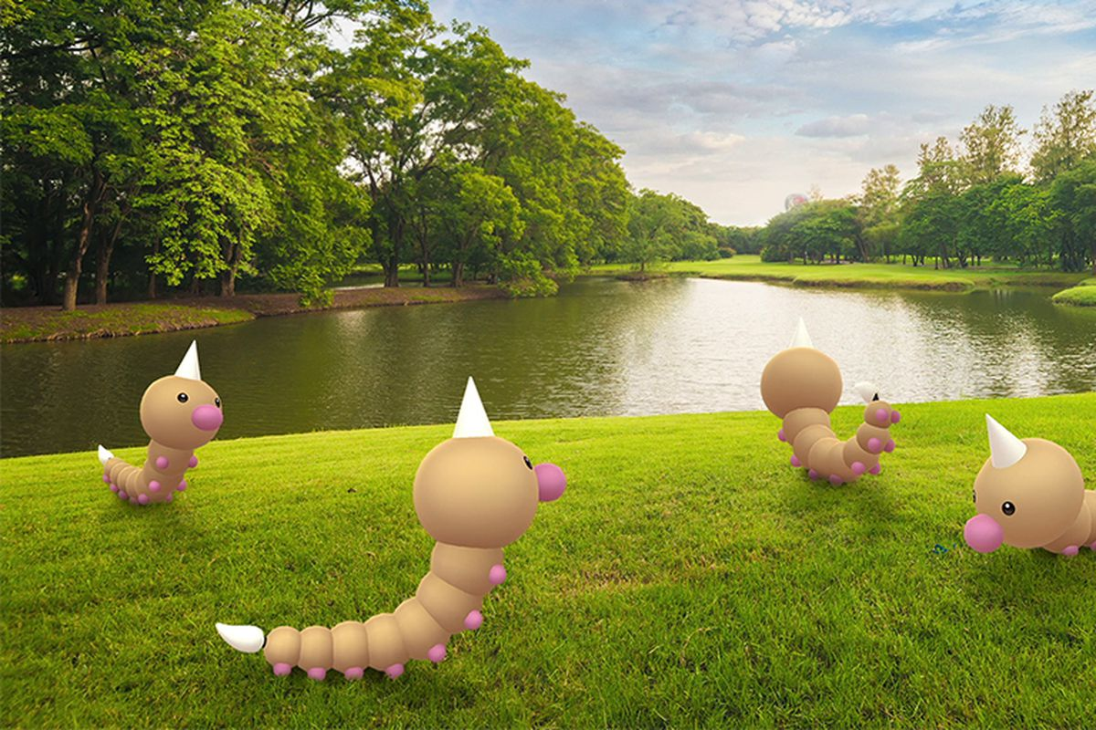 A group of Weedle hang out by a pond in a photo illustration for Pokémon Go