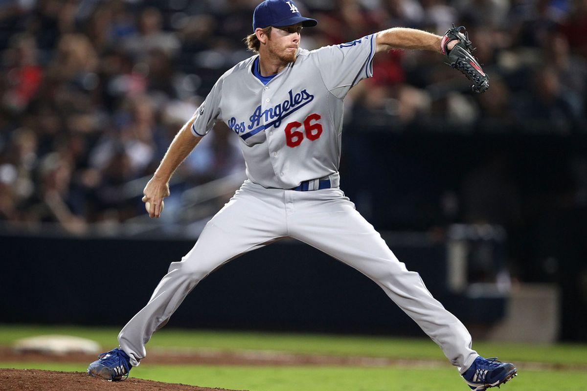 ATLANTA, GA - SEPTEMBER 02:  Pitcher Mike MacDougal #66 of the Los Angeles Dodgers throws a pitch during the game against the Atlanta Braves at Turner Field on September 2, 2011 in Atlanta, Georgia.  (Photo by Mike Zarrilli/Getty Images)