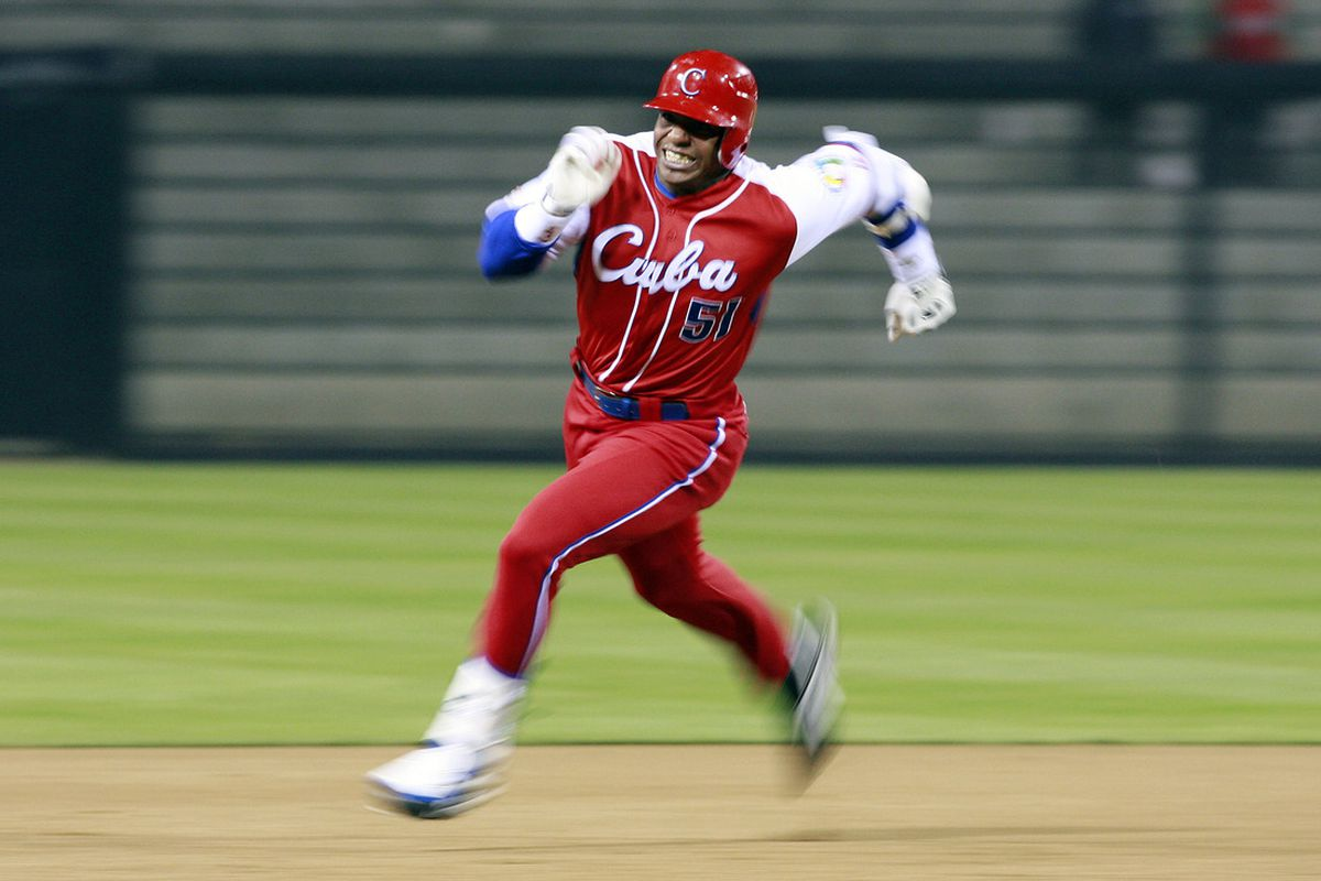 Yoennis Cespedes of Cuba runs to third base after hitting into the corner of the outfield againts Japan during the World Baseball Classic at Petco Park in San Diego, California. (Photo by Jeff Bottari/Getty Images)